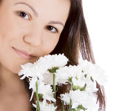 Young woman with a white flower. Stock Image