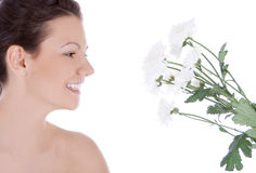 Young woman with a white flower. Stock Photos