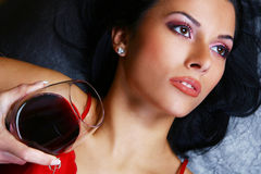 Young and sexy woman with wine Royalty Free Stock Photography
