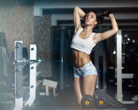 Young sexy woman after workout in gym Stock Photos