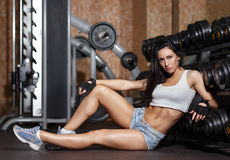 Young sexy woman after workout in gym. Stock Photos