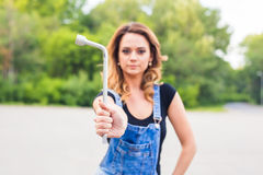 Young sexy woman with wrench in hands outdoor Stock Photo