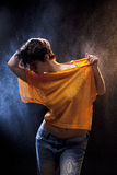Young sexy woman with yellow football shirt Stock Photos