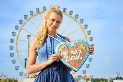 Girl with dirndl does oktoberfest wiesn in munic. Young women women girls is doing oktoberfest in munic bavaria in the spring summer autumn folk festival. she is royalty free stock photography