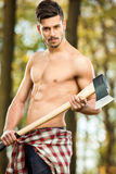 Young sexy woodcutter Royalty Free Stock Photos