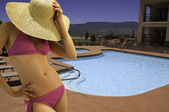 Young Shapely Poolside Female In Bikini Royalty Free Stock Photo