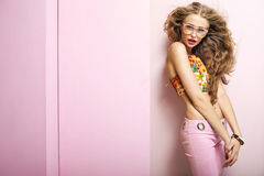 Young shapely woman in pink room stock images