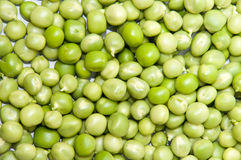 Young shelled green peas background Stock Photo