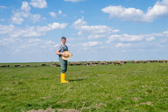 The young shepherd. Farm life,  the young man kept a flock of sheep Stock Image
