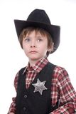 Young sheriff boy wearing a marshals badge Stock Photos