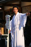A young shinto priest at Yasaka Shrine in Kyoto Royalty Free Stock Photos