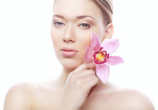 Young shiny woman with pink flower Stock Photo