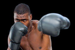 Young shirtless male boxer attacking with his left Royalty Free Stock Photo