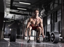 Young shirtless man doing deadlift exercise at gym. stock image