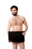 Young shirtless man holding laptop. Royalty Free Stock Photography