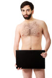 Young shirtless man holding laptop. Royalty Free Stock Photo