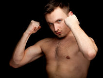 Young shirtless man ready to fight Royalty Free Stock Photos