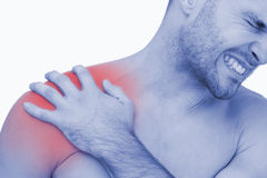 Young shirtless man with shoulder pain. Closeup of young shirtless man with shoulder pain over white background stock photos