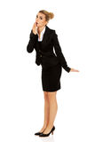 Young shocked businesswoman covering mouth.  Royalty Free Stock Photo