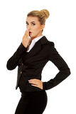 Young shocked businesswoman covering mouth Stock Image