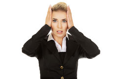 Young shocked businesswoman  olding her head in amazement and op Royalty Free Stock Photo