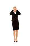 Young shocked businesswoman  olding her head in amazement and open-mouthed.  Royalty Free Stock Photo