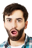 Young shocked man with mouth open. Royalty Free Stock Image