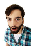 Young shocked man with mouth open. Royalty Free Stock Photography