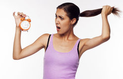 Young shocked woman holding clocks in hands Stock Photography