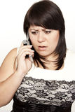Young shocked woman talking on the phone Stock Photo