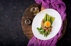 Young shoots of asparagus with ham and chicken egg yolk Stock Photography