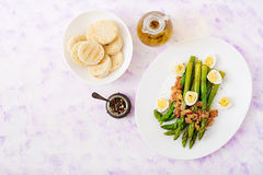 Young shoots of asparagus with ham and quail eggs. On plate Stock Photography