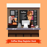 Young shop assistant serving at the cashier desk Royalty Free Stock Photos