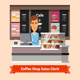 Young shop assistant serving a cup of coffee Stock Images