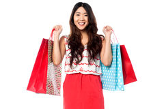 Young shopaholic girl with vibrant bags Stock Photo