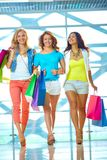 Young shopaholics Stock Photos