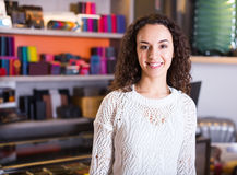 Young shopgirl in haberdashery shop Royalty Free Stock Images
