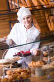 Young shopgirl posing with chocolate Royalty Free Stock Photo