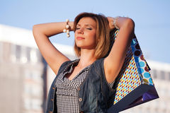 Happy young fashion woman with shopping bags  Stock Photography