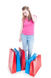 Young shopper girl looking at her new buyings. As shopping concept isolated on white background stock photo
