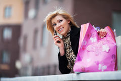 Young shopper on the phone Royalty Free Stock Photography