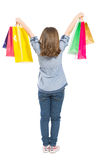 Young shopping girl from behind standing Royalty Free Stock Photos