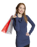Young shopping woman. Beautiful young woman holding several shopping bags Stock Image