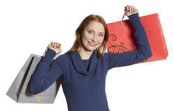 Young shopping woman. Beautiful young woman holding several shopping bags Royalty Free Stock Image
