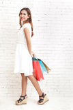 Young shopping woman carrying shopping bags while walking Royalty Free Stock Image