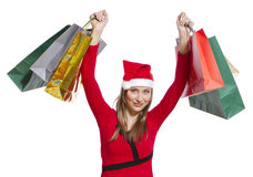Young shopping woman with Christmas hat. Beatiful young woman with Christmas hat holding several shopping bags Stock Photography