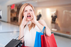 Young shopping woman with colored gift bags Royalty Free Stock Photos