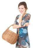 Young shopping woman with wicker basket Royalty Free Stock Photo