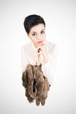 Young short hair fashion model holding fur jacket looking at camera Royalty Free Stock Photos