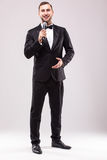 Young Showman presenter with microphone against white background. Stock Photo